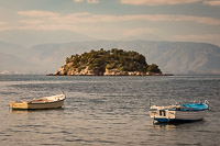 Two Boats Floating in fornt of an Island in the Aegean Sea