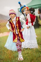 Young Girl Dancing in Traditional Clothes
