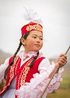 Portrait of a Kyrgyz Girl in Traditional Red Dress
