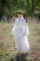 Kyrgyz Girl in Traditional White Dress