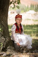 Portrait of a Young Kyrgyz Girl in Traditional Dress