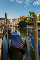Gondolas Parked in a Venice Canal