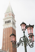 Pigeons on a Streetlight in front of San Marco's Bell Tower