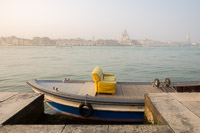 Yellow Sofa Carried on a Boat in a Venetian Foggy Morning